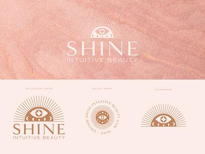 Shine Intuitive Beauty beauty salon beauty spa moon sunburst eye shine wellness skincare graphic design design branding logo vector illustration