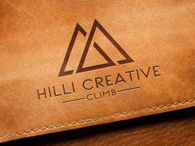 Logo Design for Hilli Creative logo mockup graphic designer logo design branding showcase realistic photorealistic mock-up identity graphicriver logo engraved