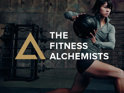 The Fitness Alchemists white symbol triangle brand workout gold fitness logo