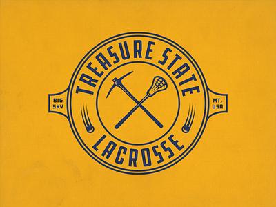 Treasure State Lacrosse logo gold blue pickaxe montana lacrosse