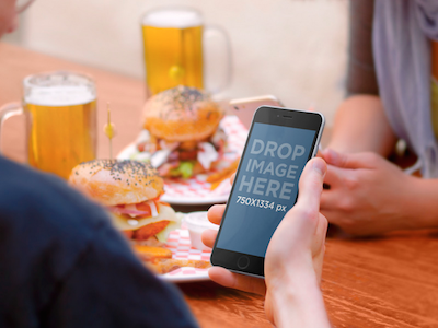 iPhone 6 Mockup of Friends Eating Out iphone 6 iphone 6 psd psd template iphone template free mockup free psd iphone 6 mockup mockup
