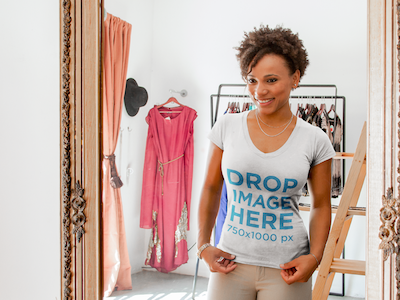 T-Shirt Mockup of a Girl Trying on Clothes at a Boutique