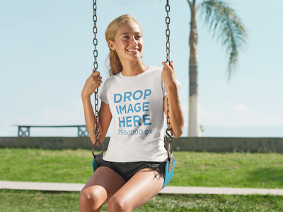 T-Shirt Mockup Featuring a Beautiful Girl on a Swing
