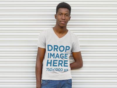 Man Standing Against a Rollup Steel Door T-Shirt Mockup