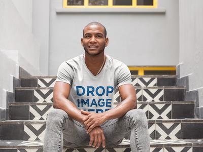 Man Sitting on a Mosaic Tile Staircase T-Shirt Mockup