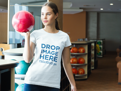 T-Shirt Mockup Featuring a Girl at a Bowling Center