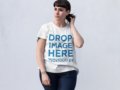 T-Shirt Mockup of a Fashionable Hipster Woman in the Street