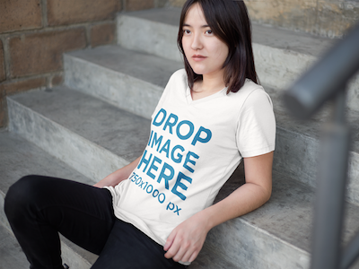 T-Shirt Mockup of an Asian Woman Sitting on a Stairway