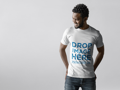 T-Shirt Mockup of an Attractive Young Man Smiling