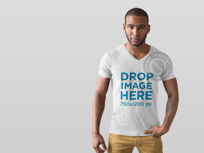 T-Shirt Mockup of a Handsome Man in a Photo Studio