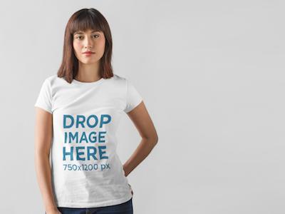 T-Shirt Mockup of a Young Woman Posing at a Photo Studio