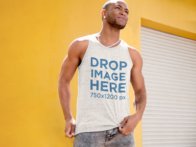 Tank Top Mockup of a Man Standing in Front of a Yellow Wall mockup tools stock photo template stock photo mockup content marketing clothing mockup template digital marketing marketing tools visual marketing tools tank top mockup template tank top mockup generator tank top template tank top mockup