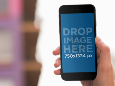 iPhone Mockup Featuring a Girl at a Boutique
