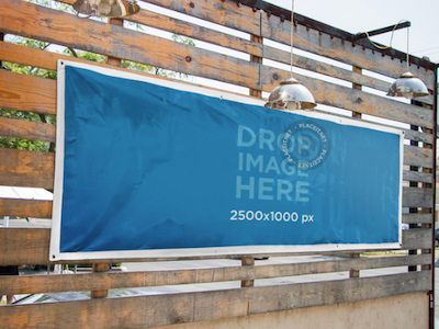Horizontal Banner Mockup Nailed to a Wooden Wall by Placeit