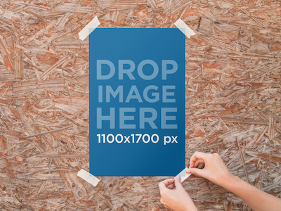 Poster Mockup Pasted to a Wooden Wall