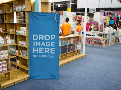Banner Mockup Standing Next to a Beauty Stand at a Trade Show ad mockup web marketing online marketing tools photorealistic template stock photo mockup stock photo template digital marketing content marketing mockup generator mockup template banner template banner mockup