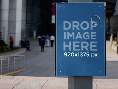Poster Mockup Nailed to a Lamp Post in the Street