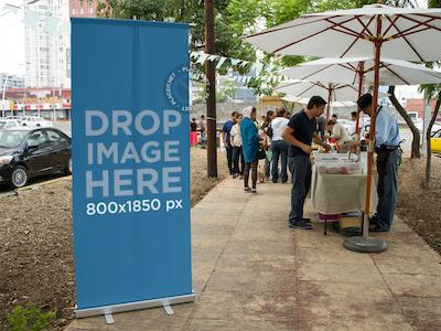 Vertical Banner Mockup at a Street Market