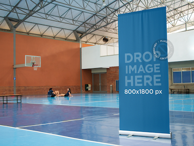 Vertical Banner Mockup at an Indoor Basketball Court