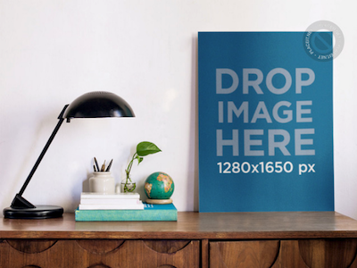 Mockup Template of a Poster Standing on a Wooden Desk