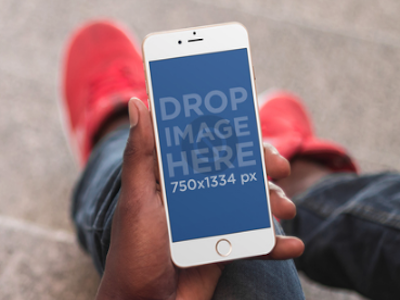 iPhone Mockup of a Guy Sitting on a Stone Staircase