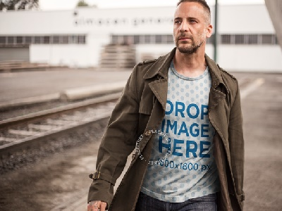 T-Shirt Mockup of a Handsome Man at a Construction Site