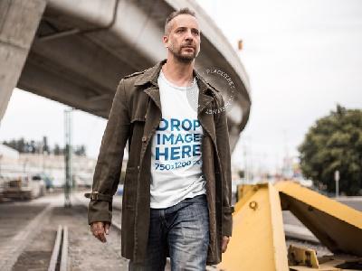 T-Shirt Mockup of a Man Walking Along a Railway