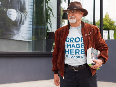T-Shirt Mockup of a Man on the Street Carrying books