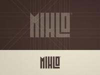 Mihlo - Wordmark Grid Design type art lettering ratio golden spiral wordmark grid layout typography logotype designer logo design brown branding brand identity