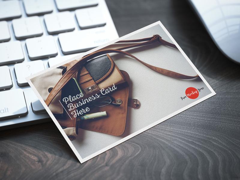Free business card on keyboard psd mockup