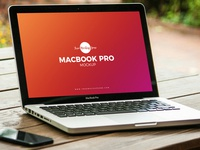 Free MacBook Pro on Outside Table Mockup PSD