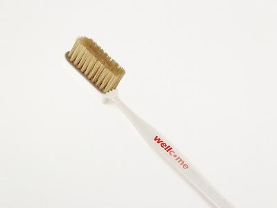 Wellcome — Toothbrush merchandising bathroom toothbrush logo wellcome brand design coliving brand identity brand mbrt identity design branding