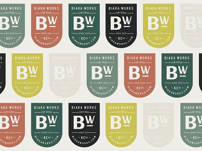 Biaka Works Badge Pattern badge crest moss moss green mustard terracotta logo design shield