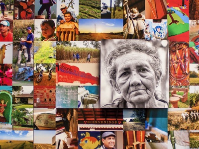Worlds Apart, Cities Connected.  A photojournalism exhibition. branding design large scale full color collage grid layout wisdom love sewing world travel hairfuts paraguay nature photography photography storytelling history exhibition display portrait