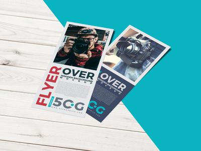 Free Flyer Over Wooden Background PSD Mockup