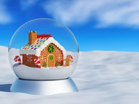 Christmas snow globe with gingerbread house inside