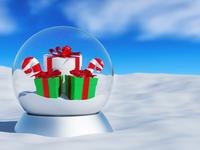 Christmas snow globe with Christmas presents and lollipop