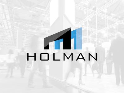Holman Exhibits quality exhibit retail kiosks icon logo