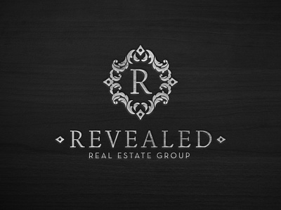 Revealed Real Estate Group strong classic wood foil wordmark group estate real logo icon