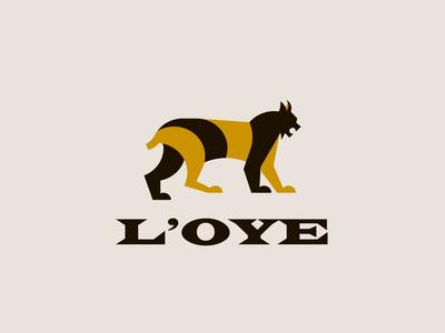 L'OYE letterforms identity logo mark tigger logo lion logo tigger logo grid fashion logo fashion branding logo design logos animal logo lynx logo lynx
