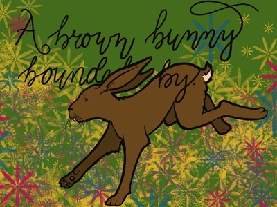 A brown bunny bounded by.
