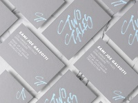 Business card mockup with Two Tales lettering logo