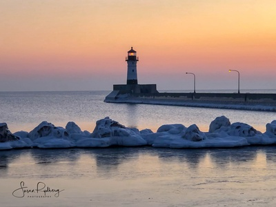 Sunrise at North Pier Lighthouse lighthouse logo travel branding travel app logo travel harbor duluth minnesota lighthouse photography branding