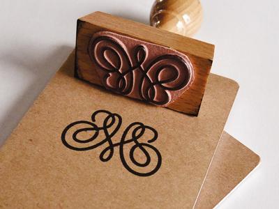 Stamp logo identity typography lettering monogram m heart swirls stamp notebook