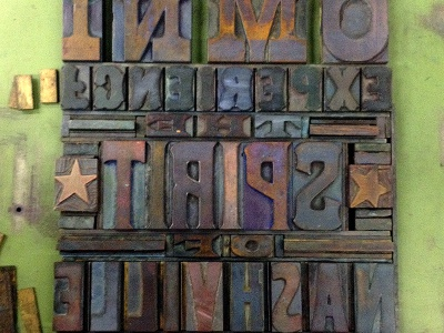 Typesetting hatch show print woodblock type lettering printmaking