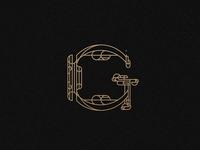 Letter G geometric logotype logo gold pattern architecture branding brand art deco typography alphabet muralnoir