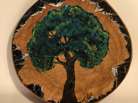 Painting of tree on wood log