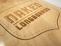 Laser-etched longboard logo