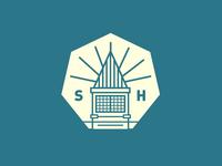 """Seven"" school logo"
