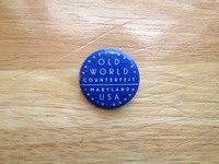 Old world counterfeit pin